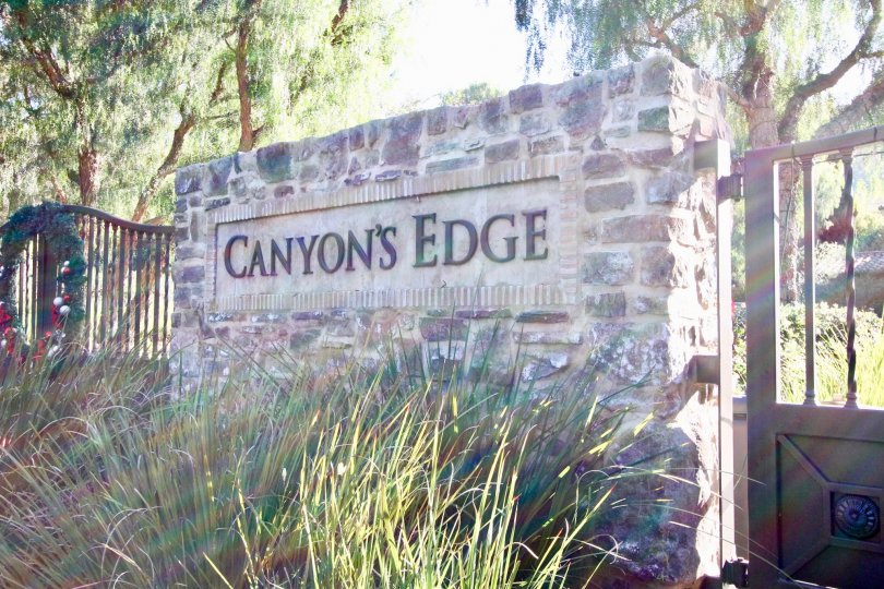 A community sign made of stone bricks outside Canyon's Edge in Irvine CA