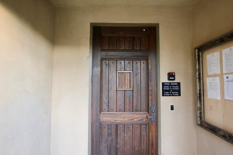 An old wooden door leading to a pool inside Chantory in Irvine CA
