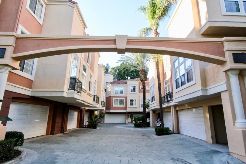Come home to a palm tree lined path and your own private garage at Corte Bella Villas