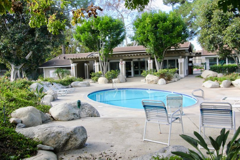 THE COTTAGE IN THE IRVINE SPRINGS WITH THE ROCKS, CHAIRS, SWIMMING POOL
