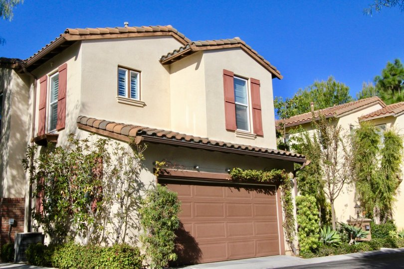 Simple and elegant two storied house on a sunny day in Ivy Wreath community.