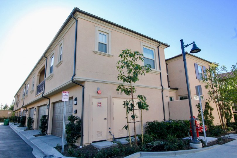 Two large and pink apartment buildings inside Jasmine located in Irvine California
