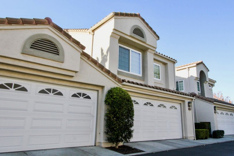 A clear day showing the white garages of a home in the Las Palmas community of Irvine California.
