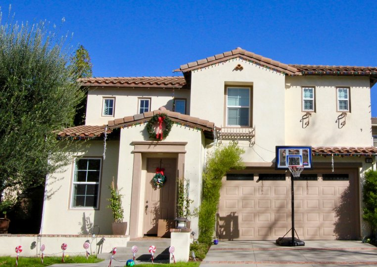 A basketball hoop in front of a garage door inside Linden in Irvine Calfironia