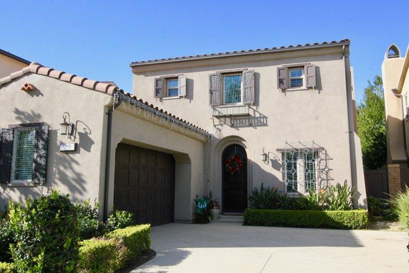 A sunny day in the area of Los Arboles, condo, outside, garage, light, door, windows