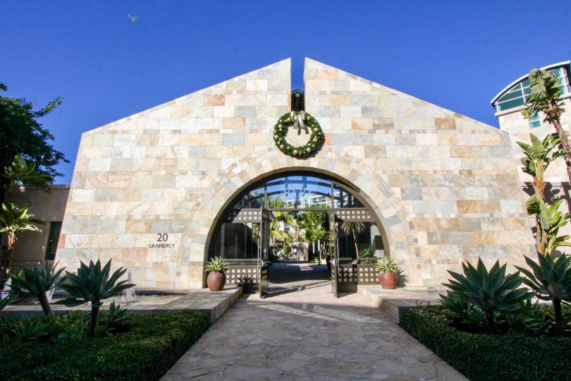 A large marble brick archway with security doors located in Manhatten in Irvine CA