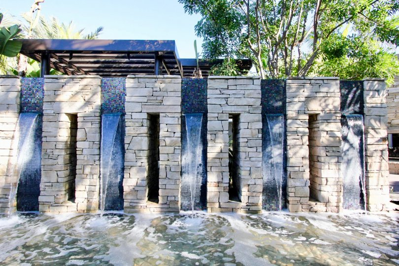 An elaborate stone brick water fountain inside Manhatten in Irvine CA