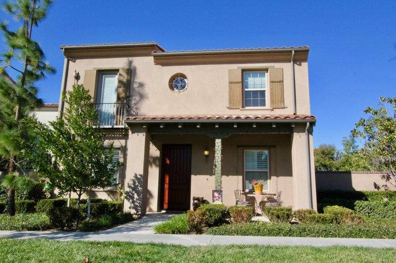 A two story pink condominium inside the Manzanita community in Irvine CA