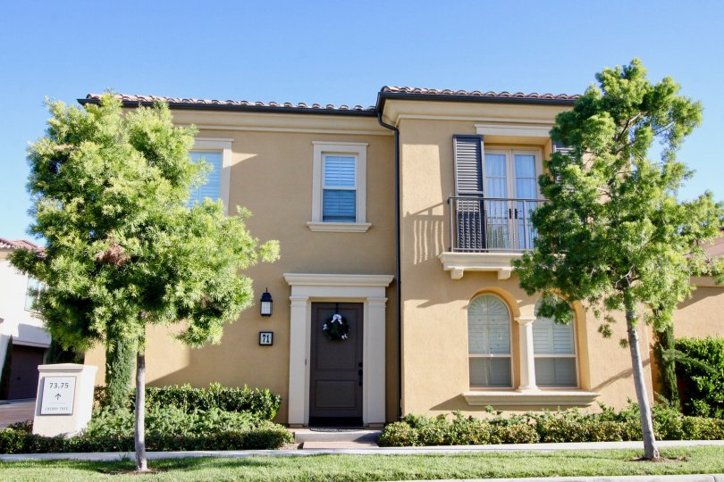 A house with massive entrance with car parking and granden at Marigold Irvine California