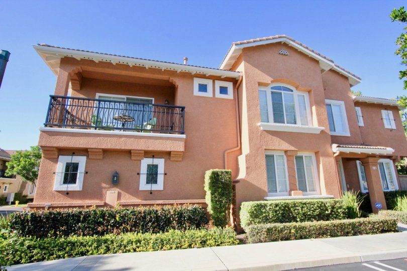 THE FRONT VIEW OF THE VILLA WITH PLANTS, PALCONY ARE THERE IN MONTILLA COMMUNITY