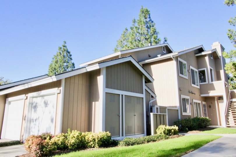 Tan paneling and white trim cover a condo building at Northwood Timberline.