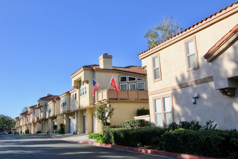 Fabulous view of villas with sunshine having USA Flags in Northwest Villas of Irvine