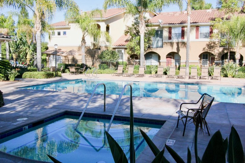 Front to the Apartment in Oak Park has Adult Pool and children's pool with seating chairs