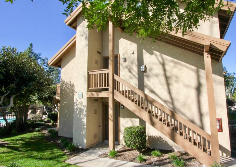Side of condos with staircase and doors on building at Orangetree Lake Condos community in Irvine, California