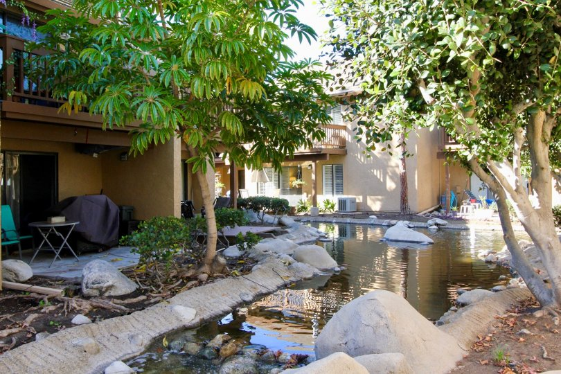 Enjoy patio views and whispering ponds at Orangetree Lake Condos in Irvine.