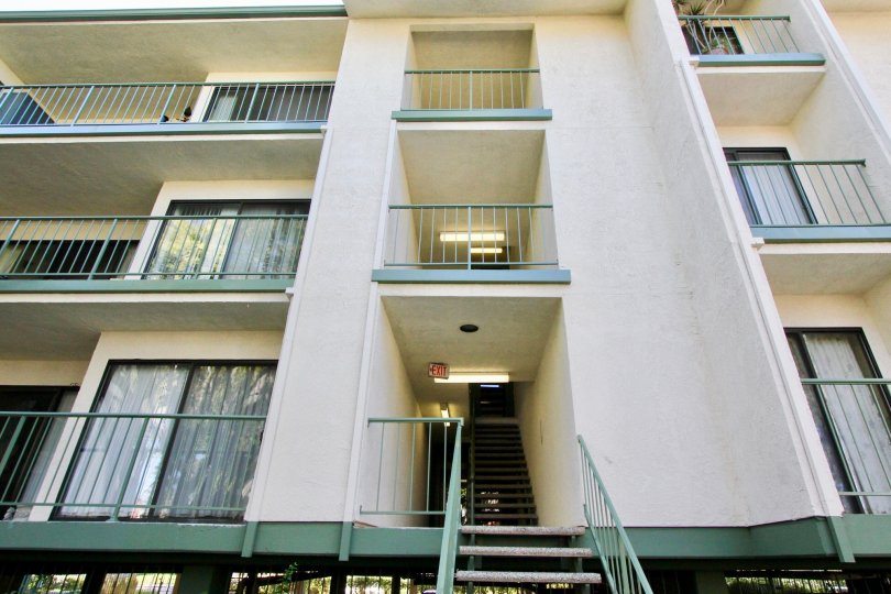Apartment in Orangetree Terrace has three floor and has way board sign 'exit' on the ceiling