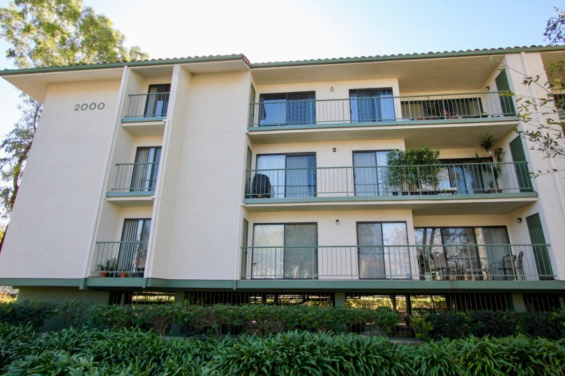The 2000th apartment in Orangetree Terrace has balconies which has flower pots and chairs