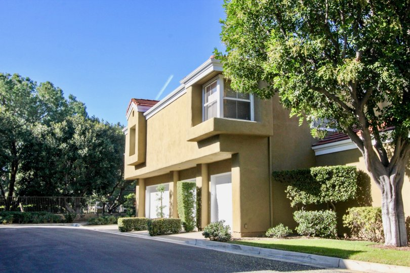 A beige house on a sunny day in the Oxford Court community of Irvine California