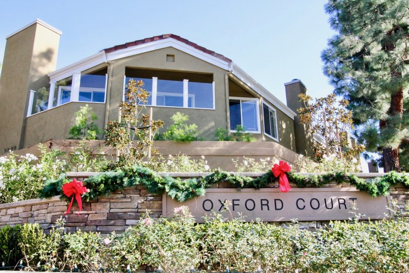 Wonderful front view of a residential house with beautiful garden to spend time with family members in Oxford court at Irvine, CA