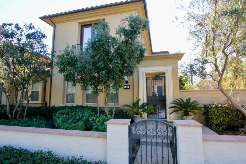 Fabulous front view with gate of villa with trees in Paloma of Irvine