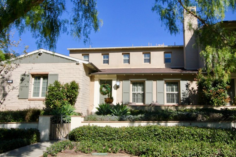 Multilevel Home located in Irvine California in the Paloma District with concrete walkway and fireplace