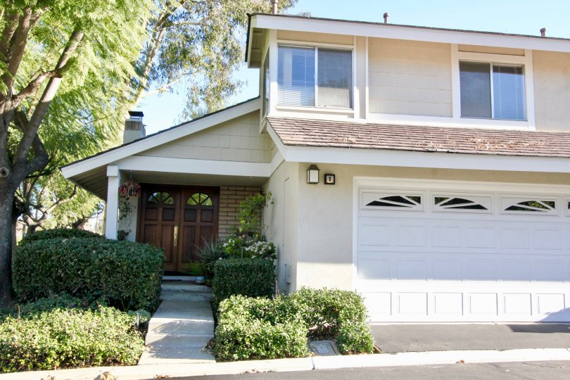 A house with massive entrance with car parking and granden at Parkside Irvine California