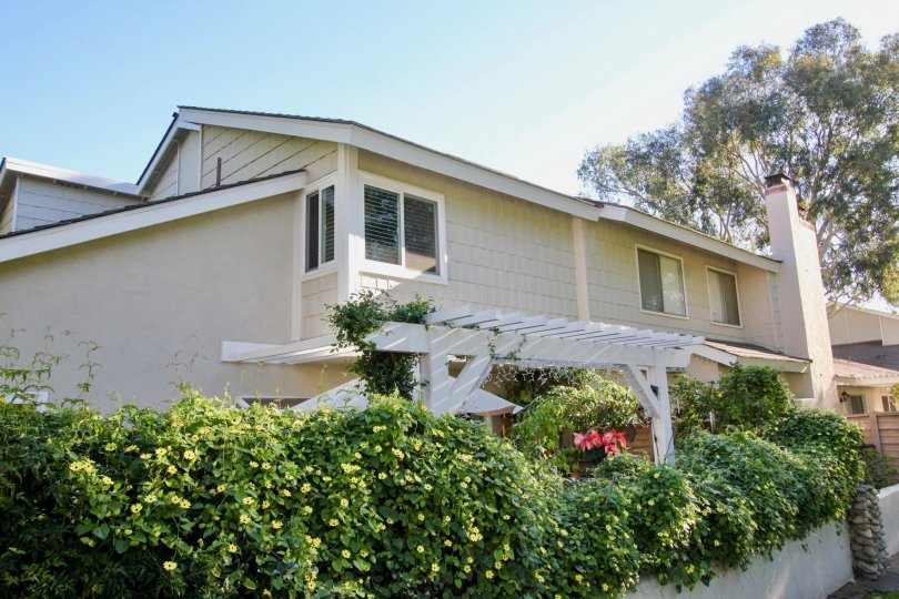 A house with many trees and pleasant entrance in Parkside Irvine california