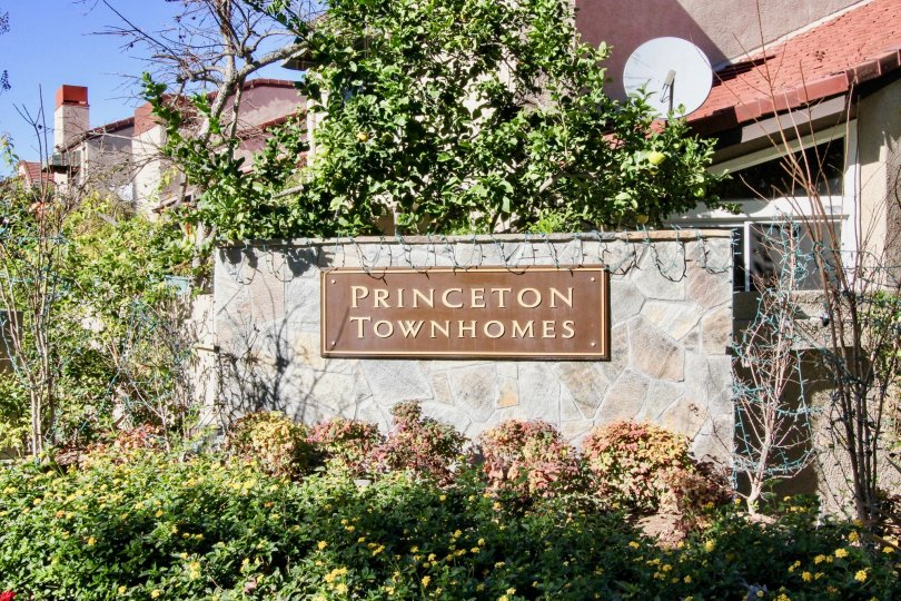 At entrance of the Villa attach a board named as Princeton Townhomes in the wall with plants
