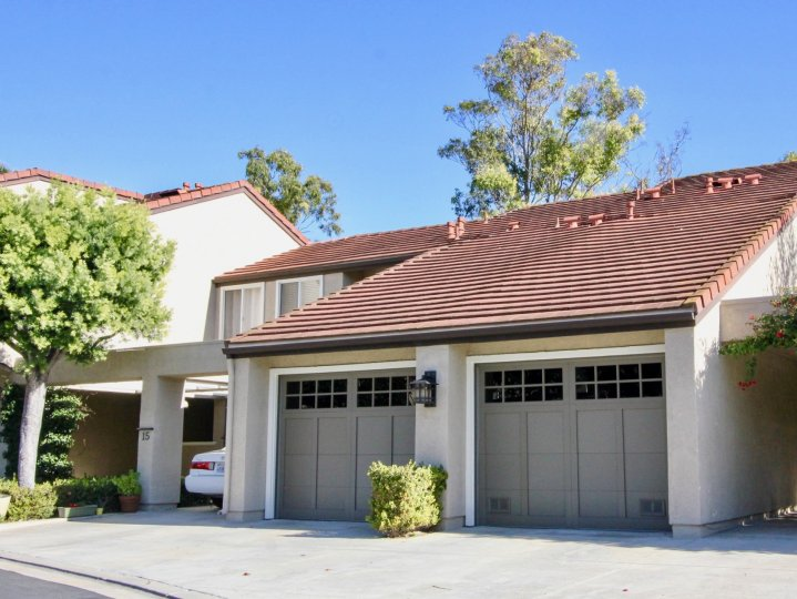 Two gray garages attached to cozy home inside Princeton Townhomes in Irvine CA