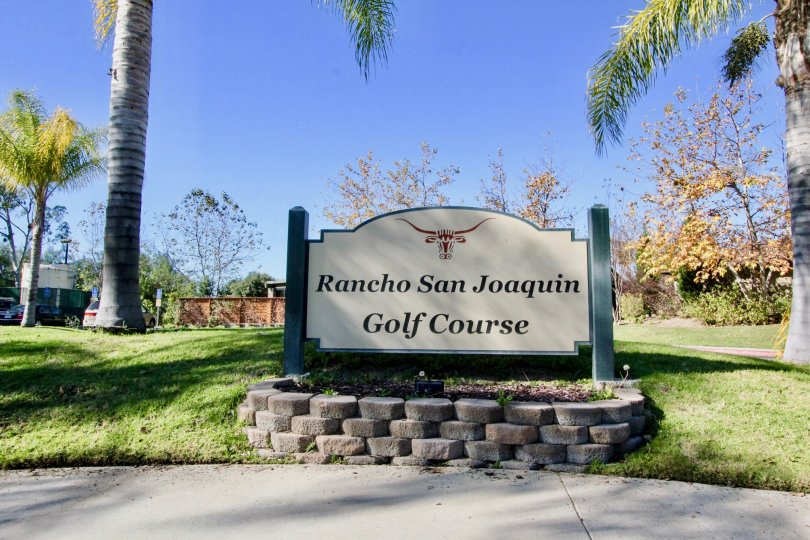 Rancho San Joaquin Golf ground in the Rancho San Joaquin Townhomes with some shrubs, tree and lawn.