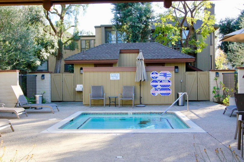 a townhouse with a pool on a sunny day in ridge townhomes akins irvine californias