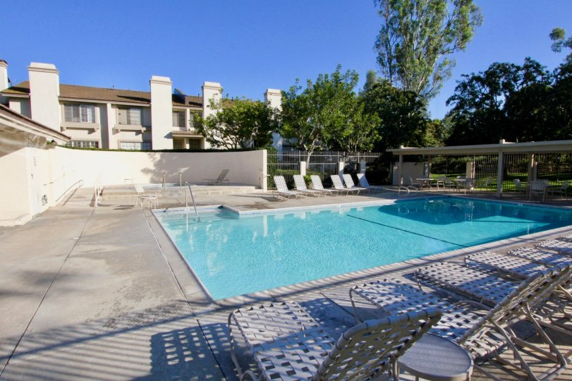 In Ridge Townhomes Bren, Swimming pool has seating chairs with dinning tables