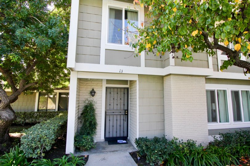 A two-storey residence in the Smoketree community with gated front door.