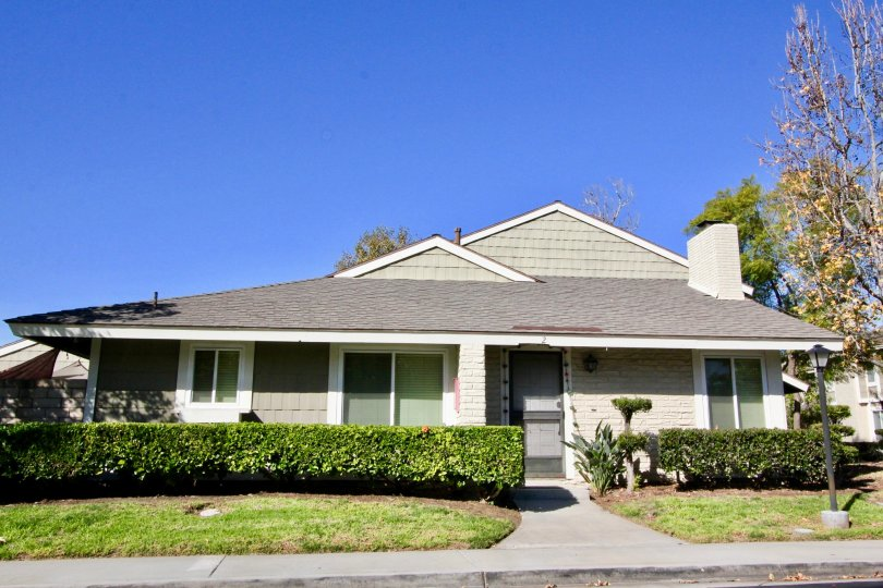 THIS IMAGE REPRESENTS THE HOME WITH LAWN, PLANTS, TREES ARE THERE IN IRVINE CITY