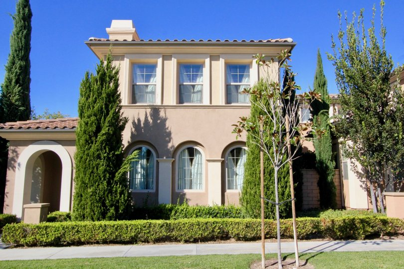 Bright blue sky behind a beautiful home in Irvine California