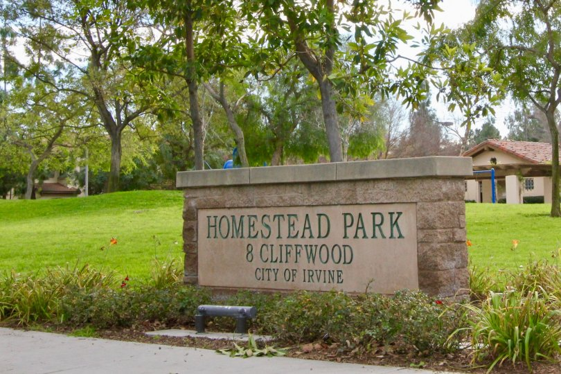 A handful of young trees sit behind the Homestead Park sign in the Summerplace community.