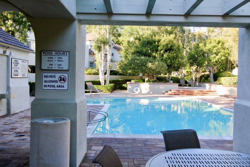 Pool hours showing in swiming Pool At Community Summit Towne Collection, Irvine, California