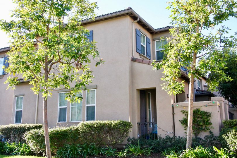 A two story condominium with decorative shutters inside Tamarisk in Irvine CA
