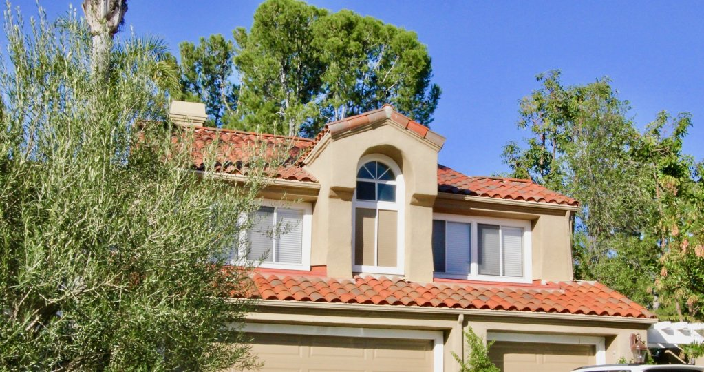 The upper story of a home in Turtle Rock Pointe on a sunny day
