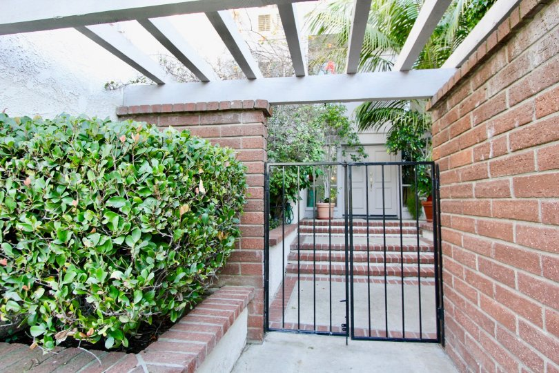 A gated entry to a home in Turtle Rock Vista surrounded by greenery