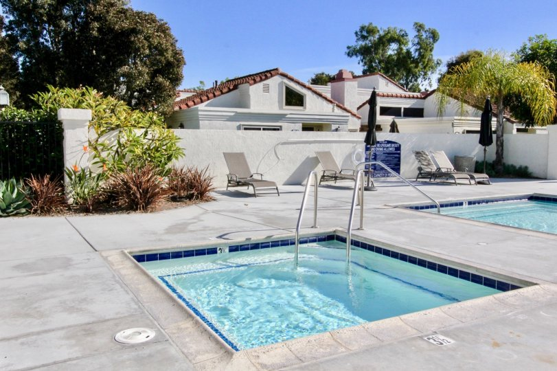 The Villas at RSJ swimming area features a large pool, spa and lounge chair area in Irvine California.