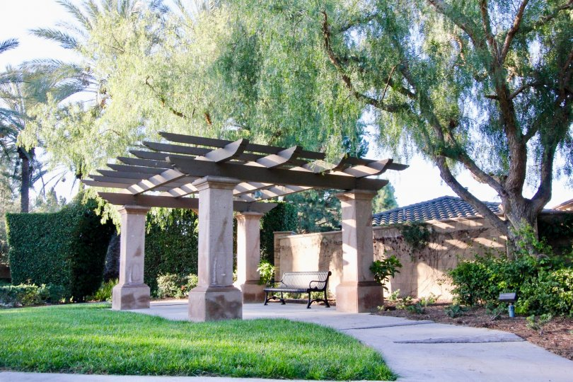 Japanese looking gate and wall with trees in garden in Vinters Reserve, Irvine CA