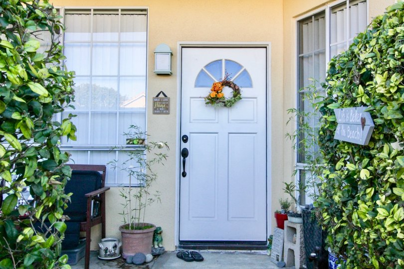 The home in vista west park with beautiful front door and lots of plants, chair