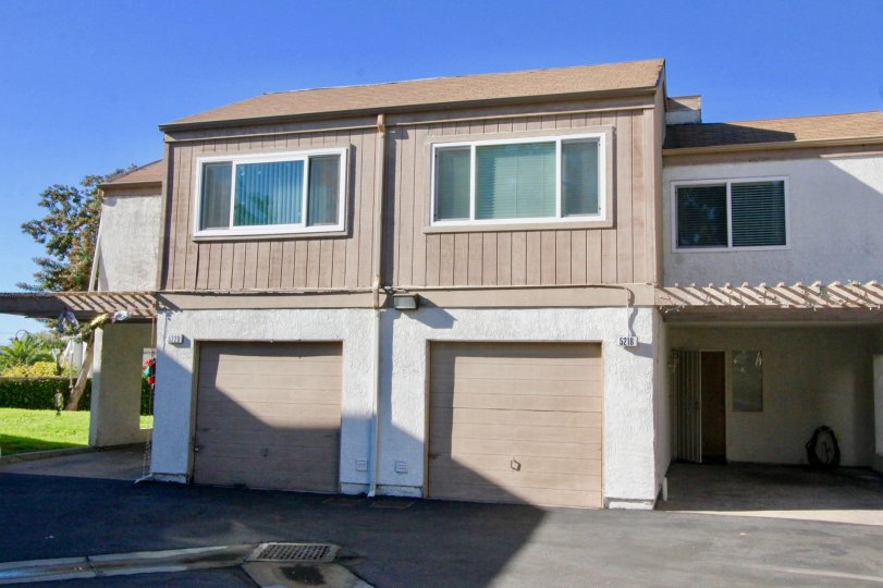 A sunny day in the area of Walnut Court, bush, condo, door, planter, roof, parking lot, hose