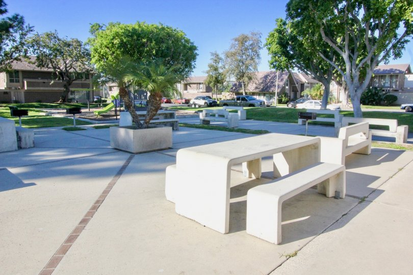 A paved park in the Walnut Square community with concrete seating.