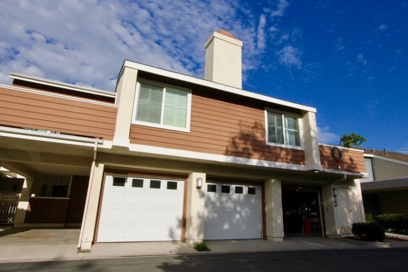 Brown townhome with chimney and attached garages at Windwood Townhomes in Irvine CA
