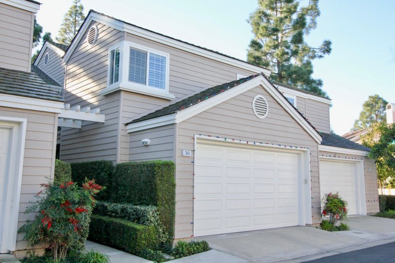 Elegant two-story beige gray home in Woodbridge Cove, Irvine CA