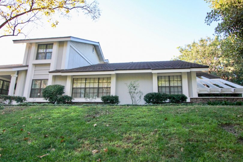A two story town home with many windows on a hillside in Woodbridge Estates in Irvine CA