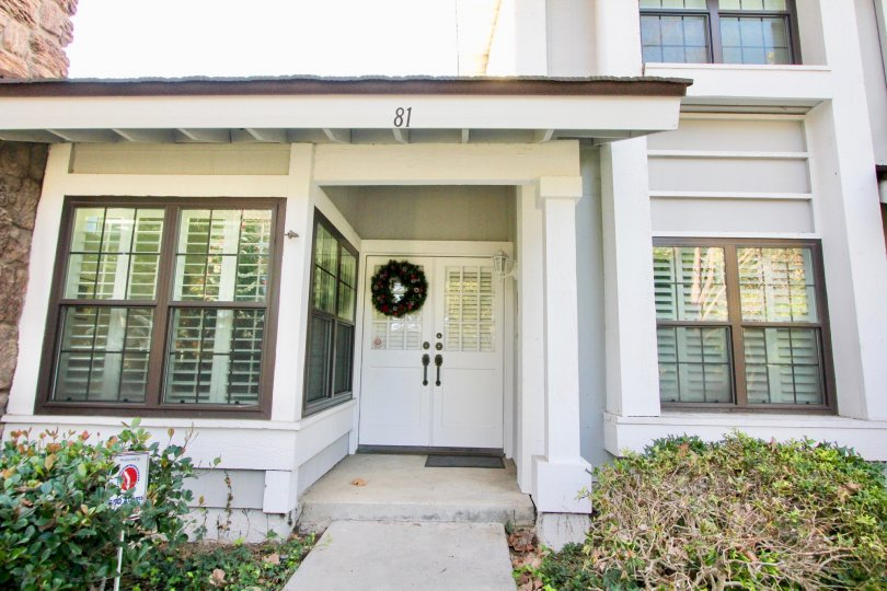 A front entrance in Woodbridge Estates community with louvered windows.