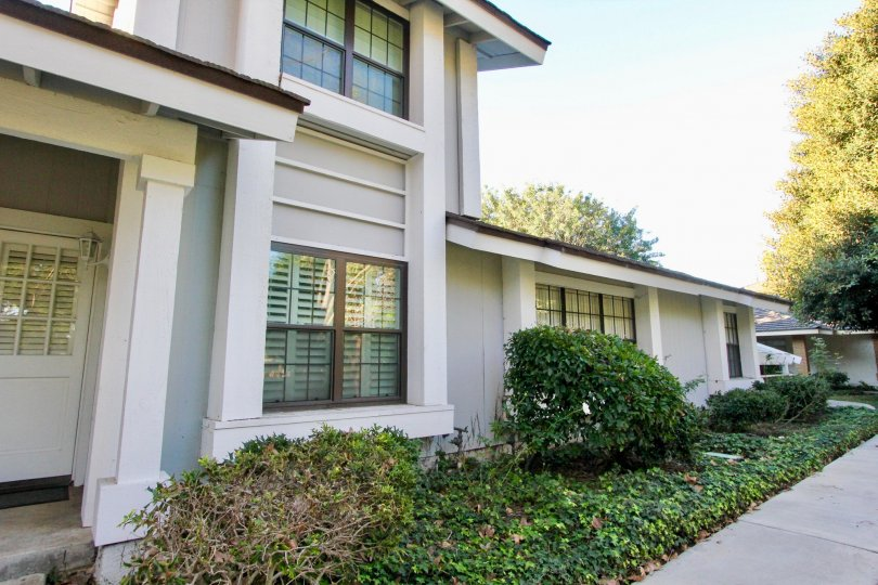 A two-and-a-half storey residence in the Woodbridge Estates community with louvered windows.